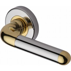 Vienna Modern Lever Handles on Rose in Polished Chrome and Brass