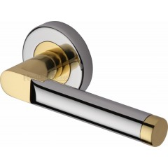 Celia Lever Handles on Rose in Chrome and Brass