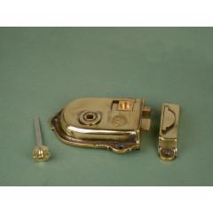 rim latch in aged brass