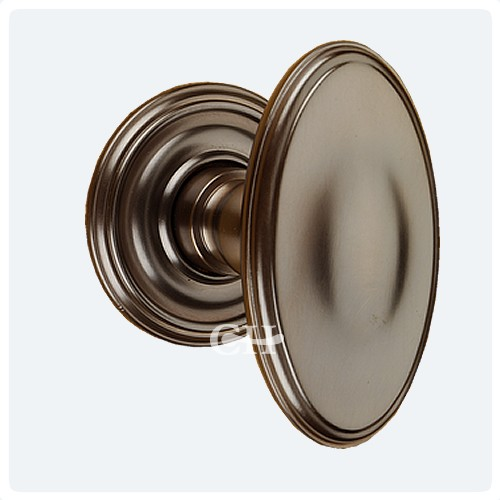 Superior Antique Brass Unlaquered Stepped Oval Door Knobs