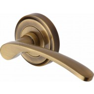 Sophia Designer Lever Handles on Rose in Antique Brass