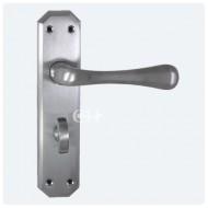eden lever handles on bathroom backplate