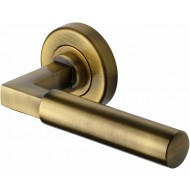Bauhaus Lever Handles on Rose in Antique Brass
