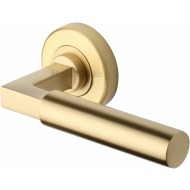 Bauhaus Lever Handles on Rose in Satin Brass
