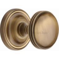 Whitehall Half Reeded Door Knobs in Antique Brass